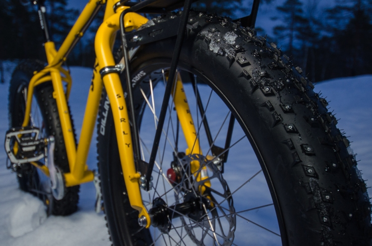 The Dillinger tires were not handling the loose snow quite as well as the Surly Nates. But they did well enough to put a big smile on dads face too. And the studs are great for icy roads and singletrack.